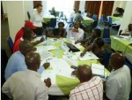Coordination-meeting-at-the-OPM,-URCS-table---Simualtion,-kampala,-June-2013-300x226