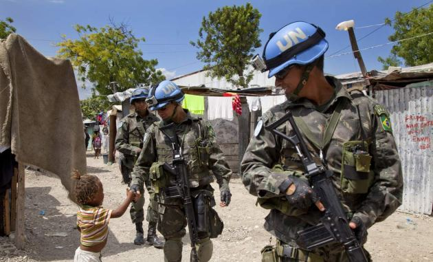 Brazilian members of the United Nation's MINUSTAH mission patrol in Haiti.