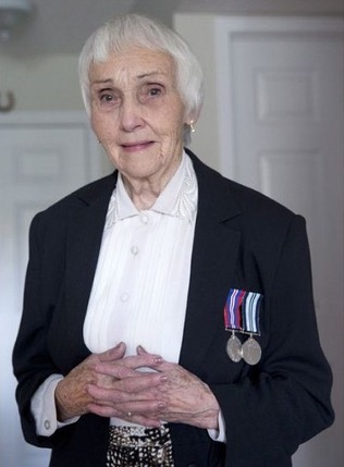 Anne Puckridge wearing her WW2 medals.