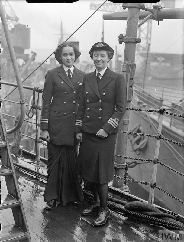 INDIAN WRENS VISIT ROSYTH, 3 JUNE 1945 (A 29070) Chief Officer Margaret L Cooper, Deputy Director of the Women's Royal Indian Naval Service (WRINS), with Second Officer Kalyani Sen, WRINS at Rosyth during their two month study visit to Britain.