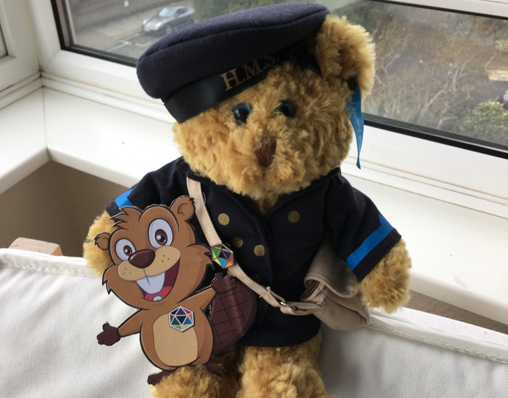 Raspberry the WATU Wren bear and Smuggie, mascot of Connections North, proudly sporting Derby House Principles pins